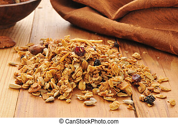 Organic granola with rolled oats, almonds, walnuts, sunflower seeds, dried, cranberries, raisins, and brown sugar