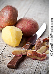 healthy organic peeled potatoes and knife