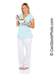healthy pregnant woman eating green salad