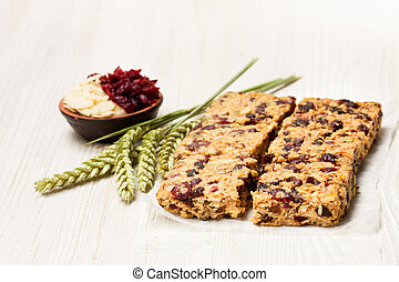 Healthy protein granola bars with dried berries and nuts on ...