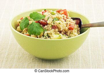 Healthy Quinoa salad in bright green bowl