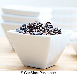 Healthy Raw Cacao Nibs Close Up - A bowl full of healthy...