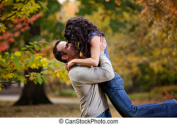 Healthy Relationship - A man giving a woman a big hug in a...