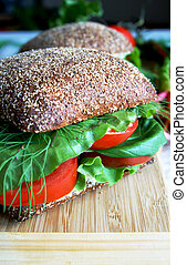 Healthy rye bread sandwich with tomatoes on a wooden board...