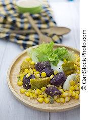 Healthy salad (lettuce, pumpkin, corn, yam and boiled egg)