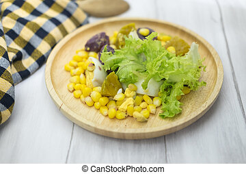 Healthy salad (lettuce, pumpkin, corn, yam and boiled egg)