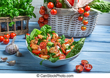 Healthy salad made with shrimp and vegetables