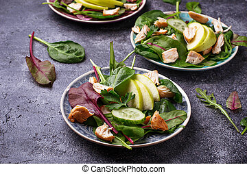 Healthy salad with chicken and apple. Selective focus