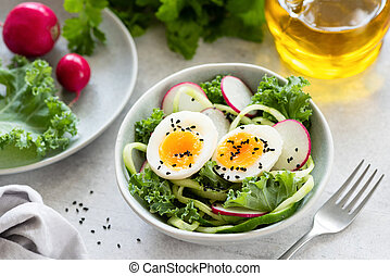 Healthy salad with egg, radish, kale and cucumber