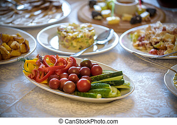 healthy salad with fresh ripe summer vegetables , tomato, cucumber , radishes , spices and white toast on a wooden background