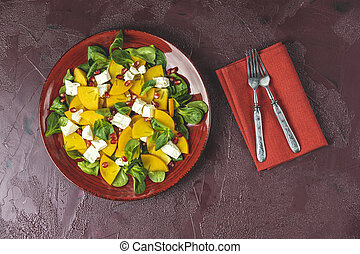 Healthy salad with persimmon, doucette (lambs-lettuce, ...