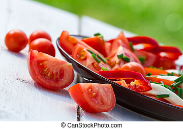 Healthy salad with tomatoes in the garden