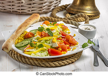 Healthy salmon salad made of fresh vegetables