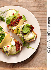 healthy sandwich with cheese, zucchini and herbs