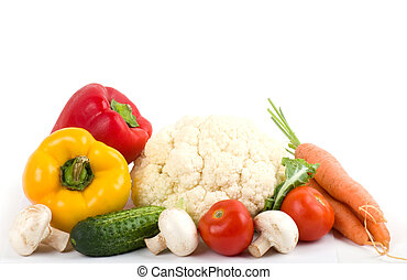 Healthy seasonal raw vegetables on white background