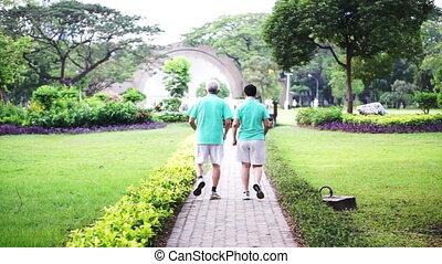 healthy senior couple exercise park