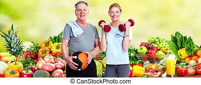 Healthy senior couple. - Healthy senior couple over fresh...