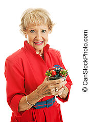 Healthy Senior Woman With Berries - Beautiful senior woman...