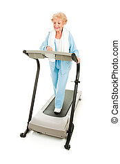 Healthy Senior Works Out - Healthy senior woman walking on a...