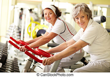 Healthy seniors  - Portrait of two senior women in gym