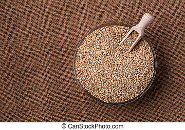 Healthy sesame seeds in a glass bowl