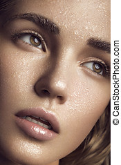 Healthy skin. Woman with drops of water on face