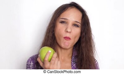 Healthy smiles young brunette woman eating green apple. Slow motion. 3840x2160