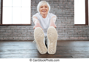 Healthy smiling woman stretching her back
