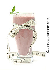 Blueberry smoothie wrapped with a measuring tape forming a bow