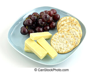 Healthy snack of cheese, crackers, and grapes on white...