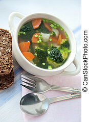 Healthy soup with wholemeal bread