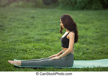 Young woman doing workout for stretching body.