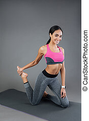 Healthy sporty woman stretching legs
