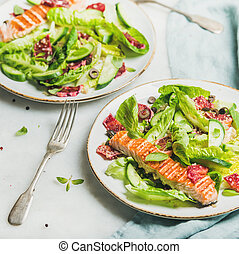 Healthy spring salad with grilled salmon, orange and quinoa