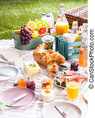 Healthy summer picnic with fruit and croissants