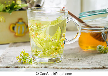 Healthy tea with honey for flu in spring day