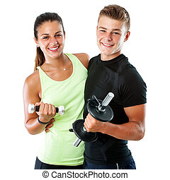 Healthy teen couple with weights.