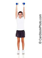healthy teenage girl exercising with dumbbells