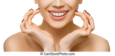 Healthy teeth and smile of a beautiful young woman isolated on white background