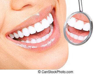 healthy teeth - Healthy woman teeth and a dentist mouth ...