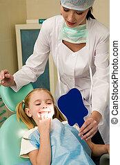 Healthy teeth - Photo of happy girl looking at her teeth in...