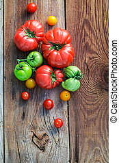 Healthy tomatoes on old wooden table