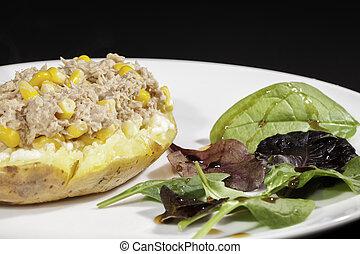 Healthy tuna sweetcorn baked potato meal with side salad