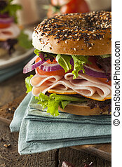 Healthy Turkey Sandwich on a Bagel with Lettuce and Tomato