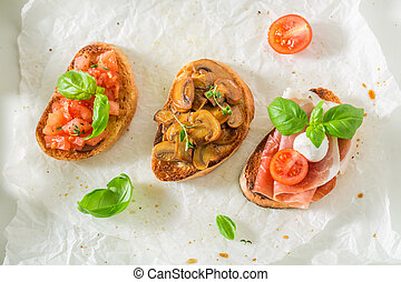 Healthy various bruschetta with fresh ingredients for a snack