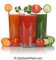 Healthy vegan eating vegetable juice from carrots, tomatoes...