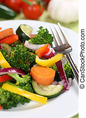 Healthy vegan meal eating vegetables food on plate