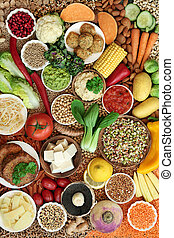Healthy vegan super food collection with fruit, vegetables, nuts, spice, dips, grains, tofu, falafel & tofu burgers High in vitamins, minerals, antioxidants, dietary fibre & smart carbs. Flat lay.