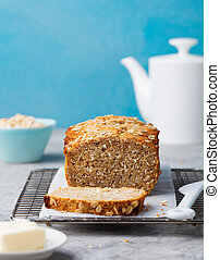 Healthy vegan oat and coconut loaf bread, cake on a cooling rack Grey stone background