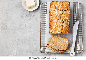Healthy vegan oat and coconut loaf bread, cake on a cooling rack Top view Copy space